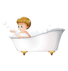 A boy playing at the bathtub while taking a bath vector