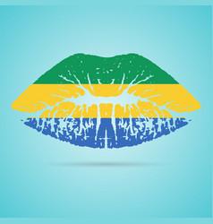 gabon flag lipstick on the lips isolated on a vector image