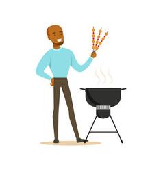 smiling african man preparing meat kebabs on a vector image