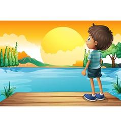 A boy watching the sunset vector