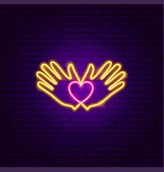 Heart hands donation neon sign vector