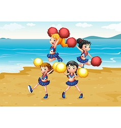 A cheering squad performing at the beach vector image