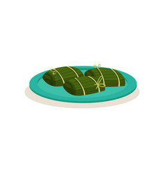 Nasi lemak wrapped in green banana leaf vector