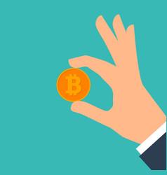 Hand holding bitcoin vector