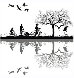 family cycling on the edge of the lake vector image vector image