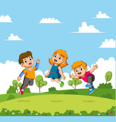 Boys and girls jumping in a beautiful garden vector