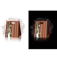 striped shopping bags with floral decorations vector image