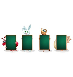 Four animals with empty green signboards vector