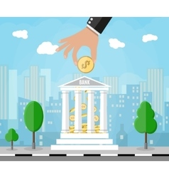 Hand putting golden coin into bank building vector