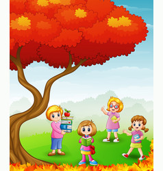 Happy children studying in the autumn trees vector