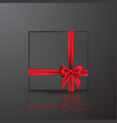 Realistic black gift box with red bow and ribbon vector
