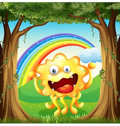 A monster at the woods with a rainbow in the sky vector