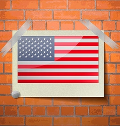 Flags USA scotch taped to a red brick wall vector image
