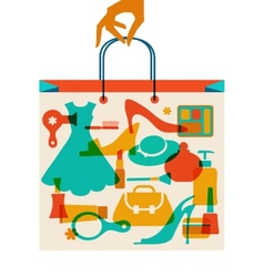 Woman hand holding hopping bag with woman cloth vector image vector image