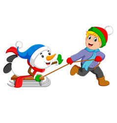 An excited boy is pulling his snowman vector