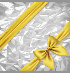 Gold ribbon and bow on bright silver foil texture vector