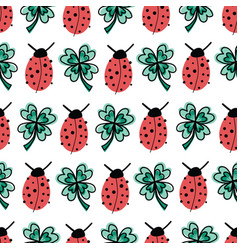 good luck four-leaf clover and ladybug charms vector image