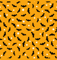 Seamless pattern with bats flying in the orange vector