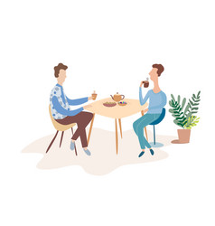 Two men are talking at a table in a cafe vector