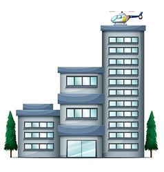 A helicopter above the tall building vector image