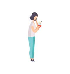 young brunette woman eating ice cream enjoying vector image
