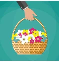 Hand Carrying basket with flowers vector image vector image