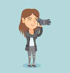 Young caucasian photographer taking a photo vector