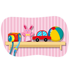camera and other toys on wooden shelf vector image