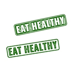 Two green grunge rubber stamps eat healthy vector