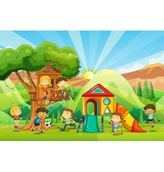 Children playing at the playground vector image vector image