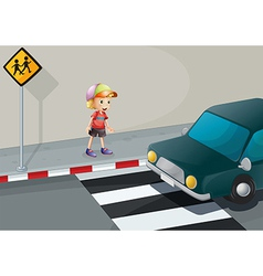 A young boy at the pedestrian lane vector