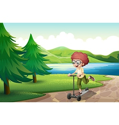 A boy playing with his scooter near the river vector