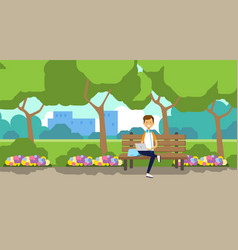 city park man holding laptop sitting wooden bench vector image