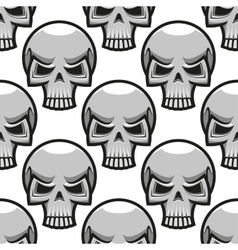 Seamless skulls pattern in cartoon style vector