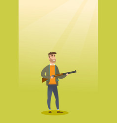 young caucasian hunter holding a hunting rifle vector image