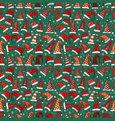 seamless pattern with red christmas santa hats vector image