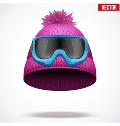 Knitted woolen red cap with snow goggles vector