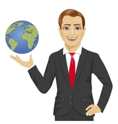 Young businessman holding globe in his hand vector image