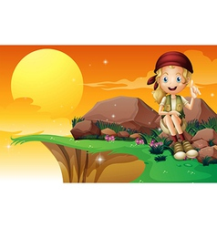 A young girl near the cliff siting above the rock vector