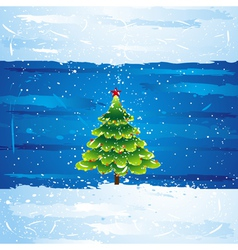 green christmas tree over blue background vector image