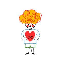 happy little boy kid holding heart shape isolated vector image