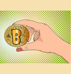 gold bitcoin in the hand of a woman pop art vector image
