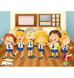 Children in uniform in the classroom vector