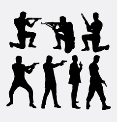 Man with gun silhouettes vector image vector image