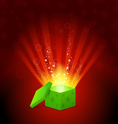 beautiful magic light shining from a green gift vector image