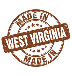 made in west virginia brown grunge round stamp vector image vector image