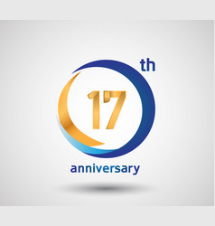 17 anniversary design with blue and golden circle vector