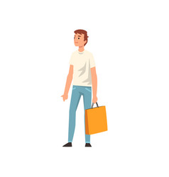 Young man standing with shopping bag guy vector