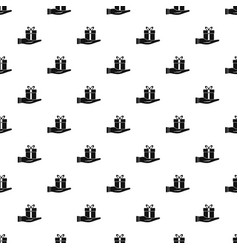 gift box in hand pattern vector image