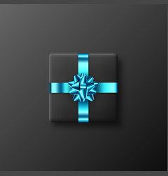black gift box with glittering blue bow and ribbon vector image